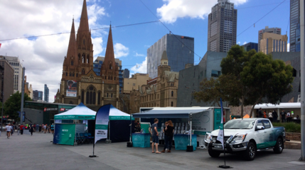 The Awareness and Education Unit set up with Stan's Van and 2 x fully branded marquees at Fed Square Melbourne, Victoria, Australia for Asbestos Awareness Week.